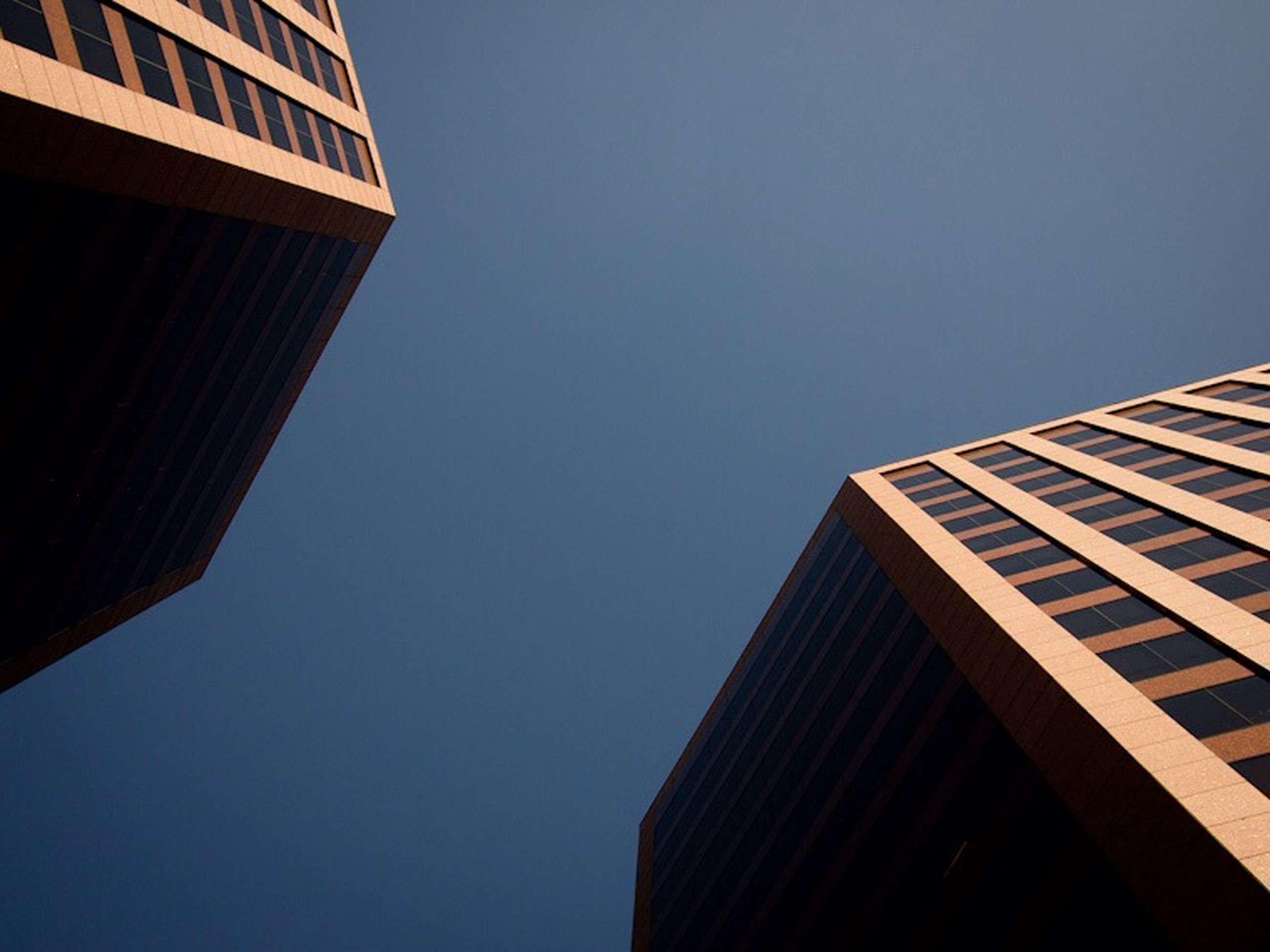 architecture, building exterior, built structure, low angle view, clear sky, city, modern, office building, building, copy space, tall - high, skyscraper, window, tower, sky, blue, outdoors, day, no people, residential building