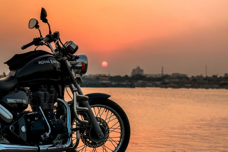 Men ride Enfield 😍 Sunset Scenics Tranquility Biker Outdoors Nature Water Day Bike Bullet Royalenfield Tamilnadu Tadaa Community Chennai Sunset_collection Travel Photography No People Beach Life Is A Beach Majestic Vehicle Beautiful Orange Color Taking Photos Bikes