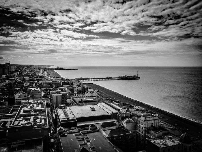 Brighton Pier On Sea Against Cloudy Sky In City