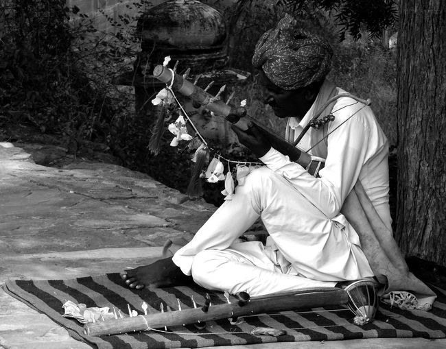 dedication... Chikara Instrument Folk Instrument Folk Songs Tradition Traditional Portrait Rajasthan Jodhpur India Blackandwhite Sitting Full Length One Person Outdoors Day Tree Sunlight Music One Man Only Musician Adult Musical Instrument Leisure Activity Lifestyles Business Stories An Eye For Travel The Photojournalist - 2018 EyeEm Awards The Portraitist - 2018 EyeEm Awards The Street Photographer - 2018 EyeEm Awards