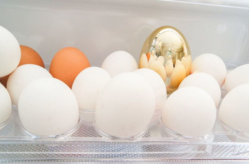 Close-Up Of Eggs In Refrigerator