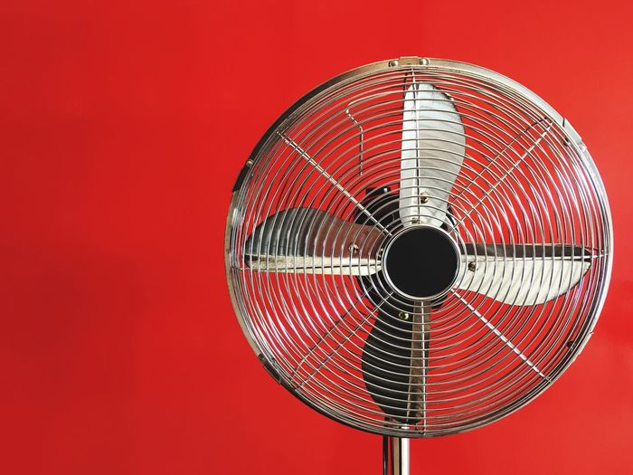 Electric fan with red background. Electrical Equipment Fan Appliance Hot Red Close-up Indoors  No People Pattern Single Object Geometric Shape Circle Red Background