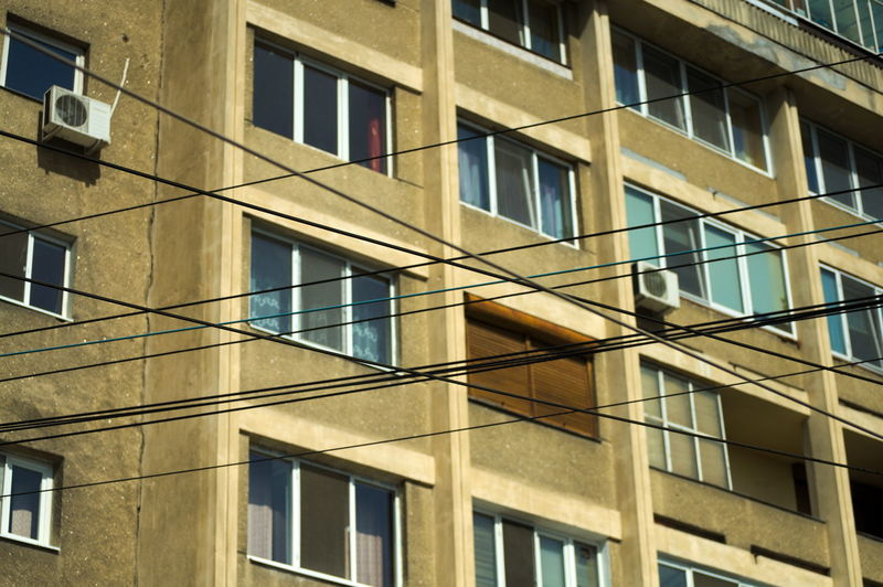 Architecture Built Structure Building Exterior Building Window No People Glass - Material City Backgrounds Outdoors Residential District In A Row Apartment Socialism Socialismmodernism Urban Lines Lines And Shapes Airconditioning Cables Pattern Modern Concrete City Blocks