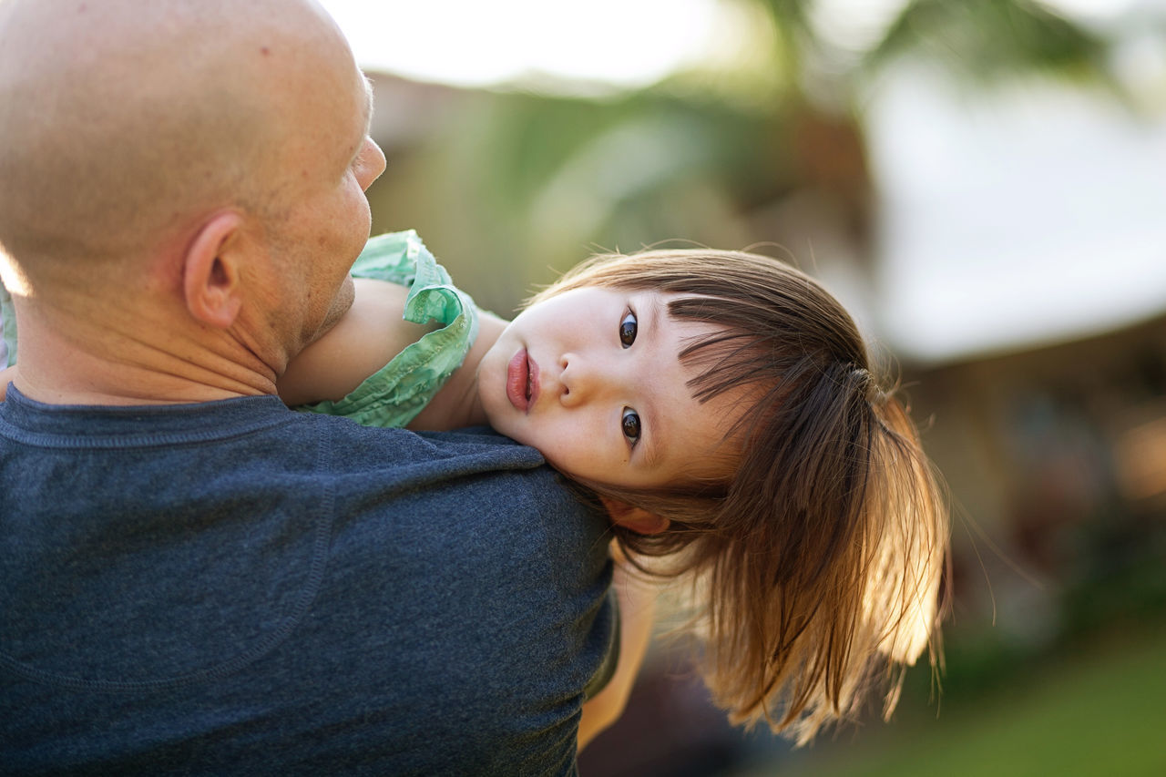 Close-up of father holding daughter