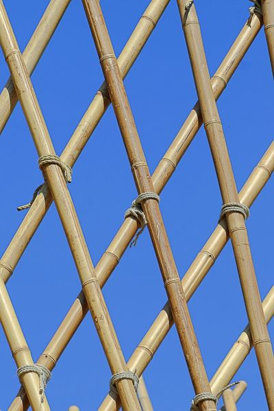 Construction Bamboo - Material Blue Bound  Checks Clear Sky Connection Day Fence Grit No People Outdoors Pattern Segregation  Sky