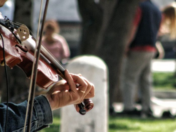 Cropped image of man playing violin