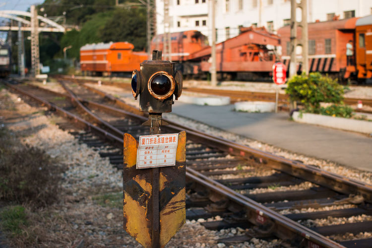 Abandoned signal by railroad tracks