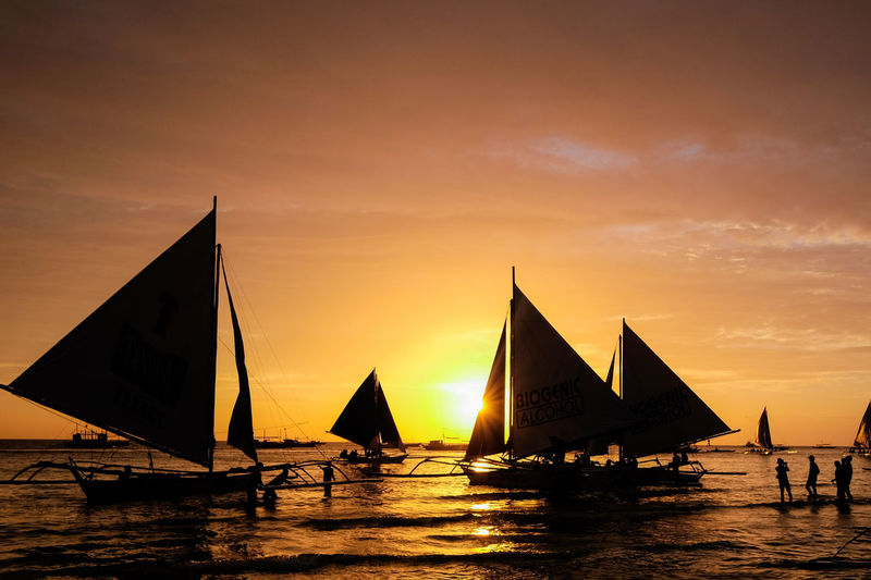 Holiday Philippines Travel Vacations Beauty In Nature Boracay Canvas Cloud - Sky Leisure Activity Lifestyles Men Mode Of Transportation Nature Nautical Vessel Orange Color Outdoors Real People Sailboat Scenics - Nature Sea Silhouette Sky Sunset Transportation Water