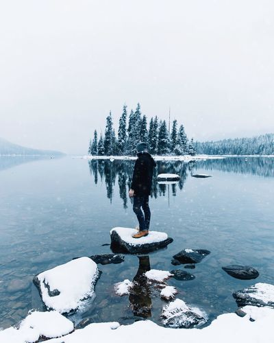 Cold moments. Cold Temperature Snow Weather Frozen Nature Real People Lake Rear View Outdoors Full Length Beauty In Nature Leisure Activity Day Water Scenics Standing Balance Lifestyles Tree