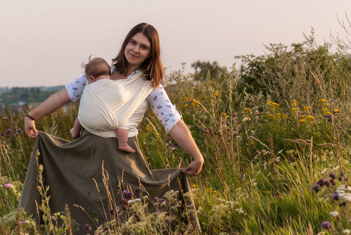 Welcome to my fairytale! Baby Baby Sling Baby Wrap Babywearing Bonding Childhood Children Family Field Front View Golden Hour Grass Happiness Lifestyle Love Maternity Mom Mother And Son Motherhood Outdoors Parenting Sling Smiling Summer Woman Live For The Story