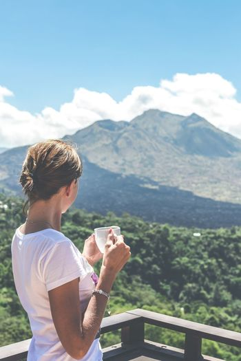 Woman Holding Coffee Cup While Looking At Mountain