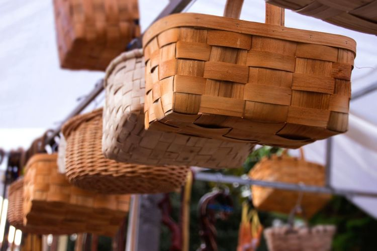 Low angle view of baskets hanging