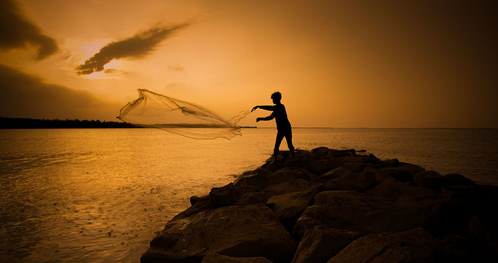 Beauty In Nature Horizon Over Water Orange Color Rock Rock - Object Scenics - Nature Sea Silhouette Sky Solid Standing Sunset Water
