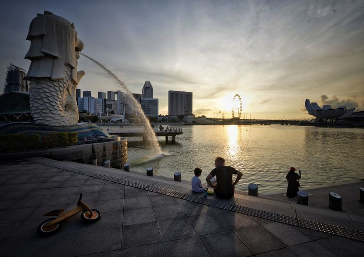 Father's Day Merlion Marina Bay Singapore Streetphotography Singapore Father & Son Father Son Water Sky Architecture Built Structure Building Exterior Sunset City Leisure Activity Lifestyles