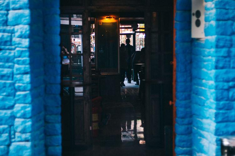 People seen from doorway of restaurant
