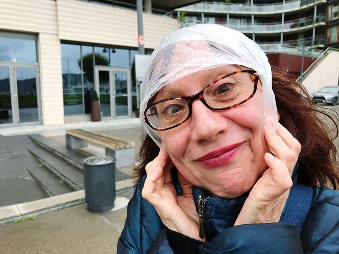 Portrait Of Mature Woman Wearing Eyeglasses Outdoors