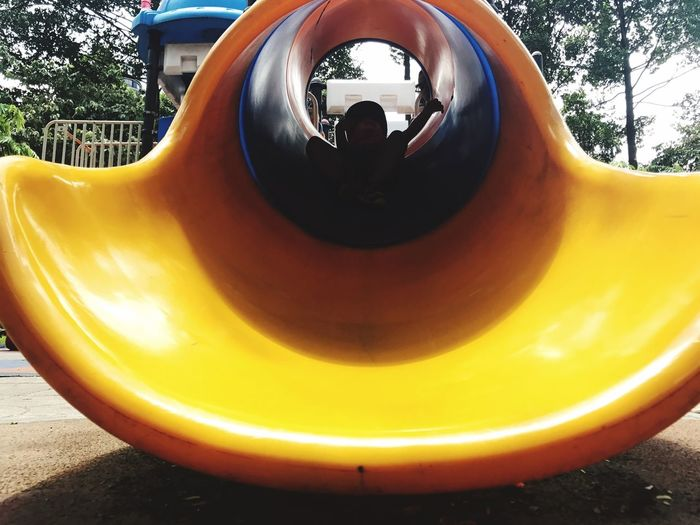 Childhood Playground Outdoors Day Outdoor Play Equipment Fun Tree One Person Water Slide Close-up People EyeEmNewHere