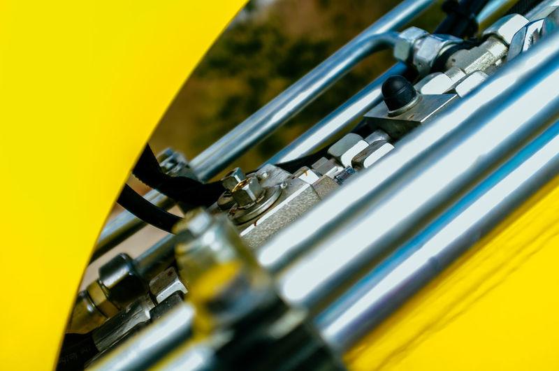 Close-up of yellow machinery