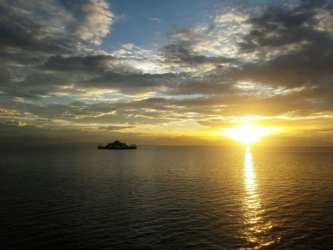 Sunset Sea Beauty In Nature Water Nautical Vessel Sunlight Dramatic Sky Outdoors No People Day Ship Cloud Cloud - Sky