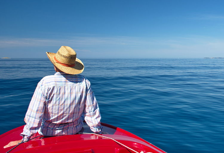Portrait of senior woman on the boat against clear blue adriatic sea