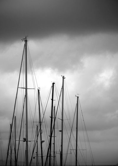 Low Angle View Of Boat Mast Against Cloudy Sky
