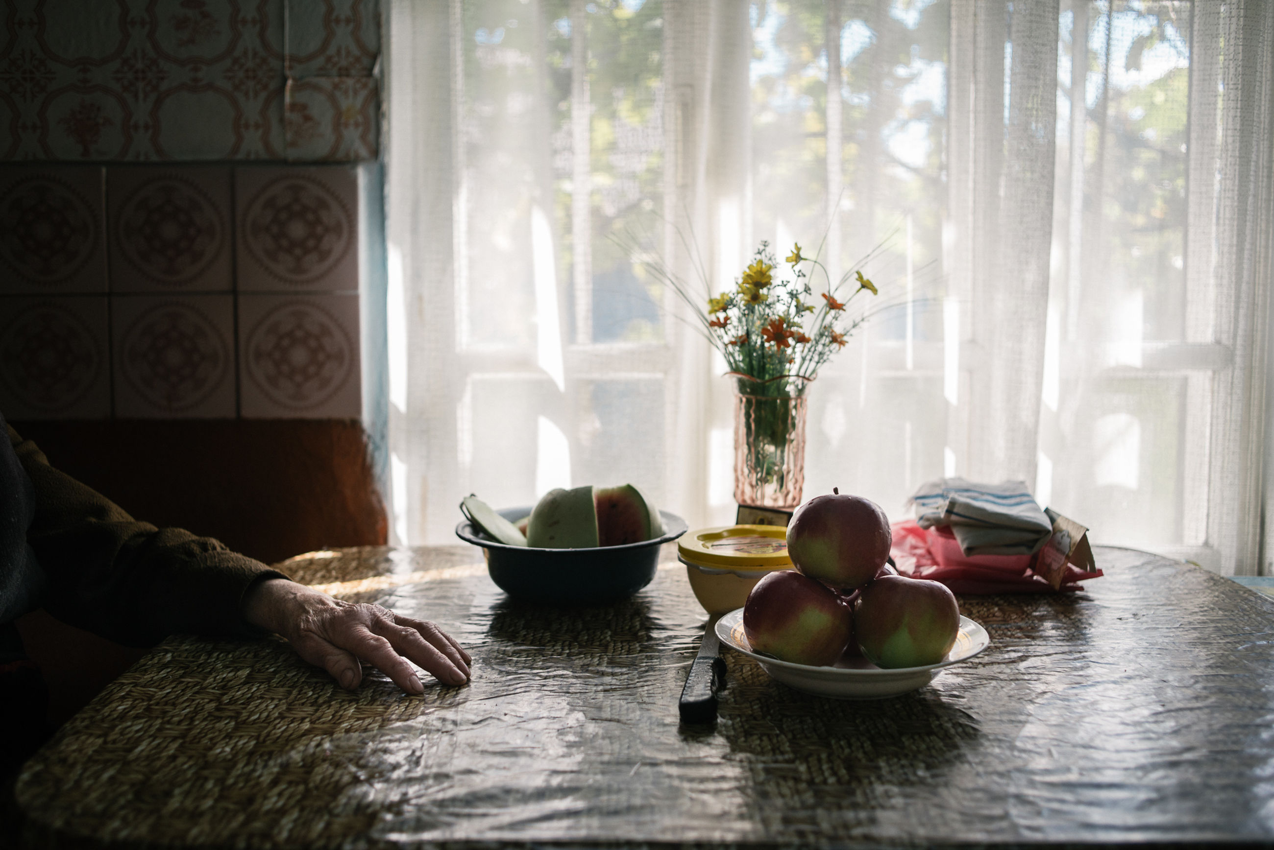 indoors, vase, window, table, curtain, food and drink, bowl, home interior, day, real people, healthy eating, flower, food, freshness