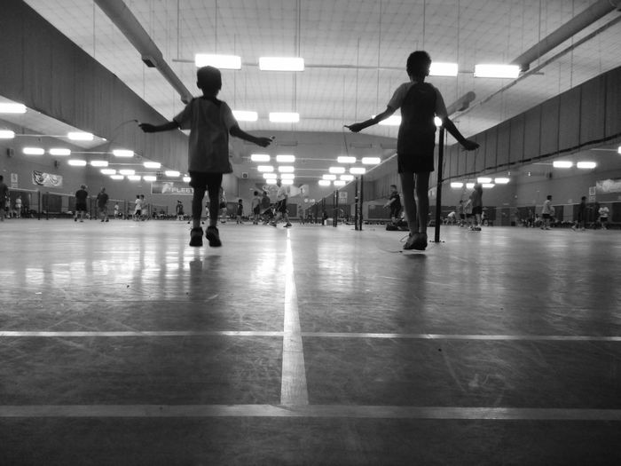 Rear View Of Boys Doing Jumping Rope