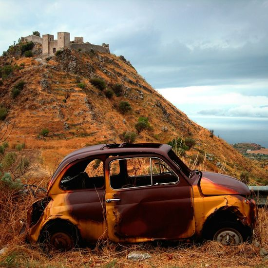 Fiat 500 and castle Fiat500 Castle Lostintime Silence South Italy Mediterranean  Sunset #sun #clouds #skylovers #sky #nature #beautifulinnature #naturalbeauty #photography #landscape Calabria (Italy) Skylovers Old Lostsouls Ghosts Silent Place