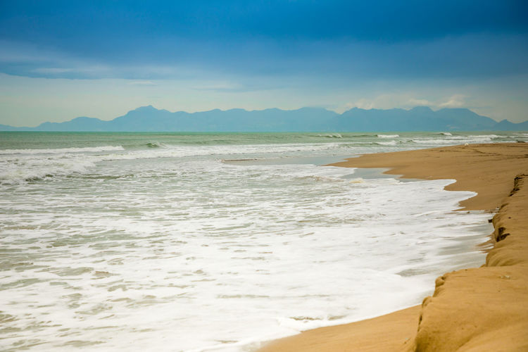 Italy Land Water Scenics - Nature Beach Sea Sky Beauty In Nature Tranquil Scene Tranquility Sand Nature Aquatic Sport Motion No People Day Sport Wave Mountain Non-urban Scene Outdoors