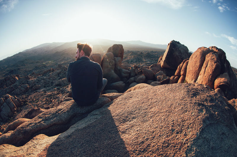 Beauty In Nature Day Joshua Tree National Park Landscape Lifestyles Men Mountain Nature One Person Outdoors People Real People Rear View Rock - Object Rock Formation Scenics Sitting Sky Stack Standing Sunlight Tranquil Scene Tranquility Women