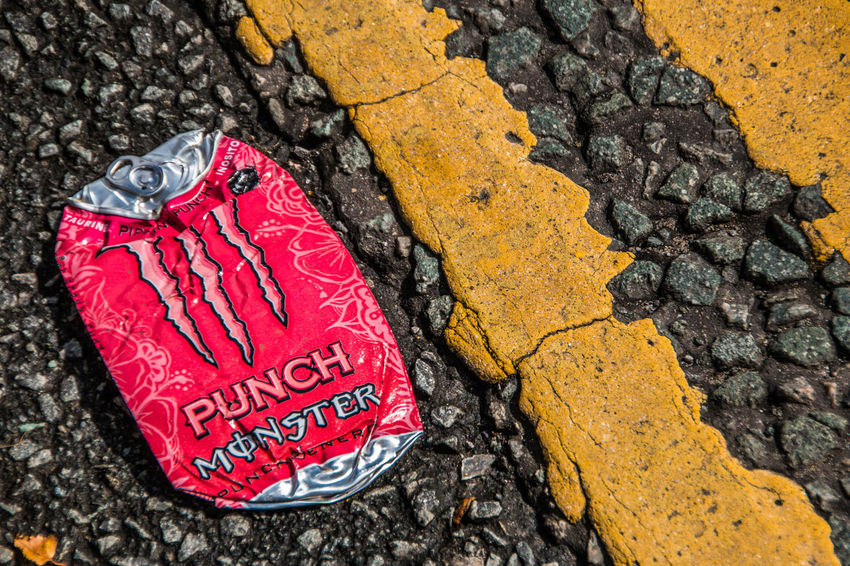 No People Close-up Text Red Day Rock Yellow Western Script Communication Solid Outdoors Textured  Tree Trunk High Angle View Focus On Foreground Road Tarmac Canon Drink Energy Drink Yellow Line Flat Squashed Leaf