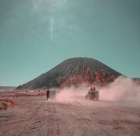 View of a car on a desert at lautan pasir bromo mountain