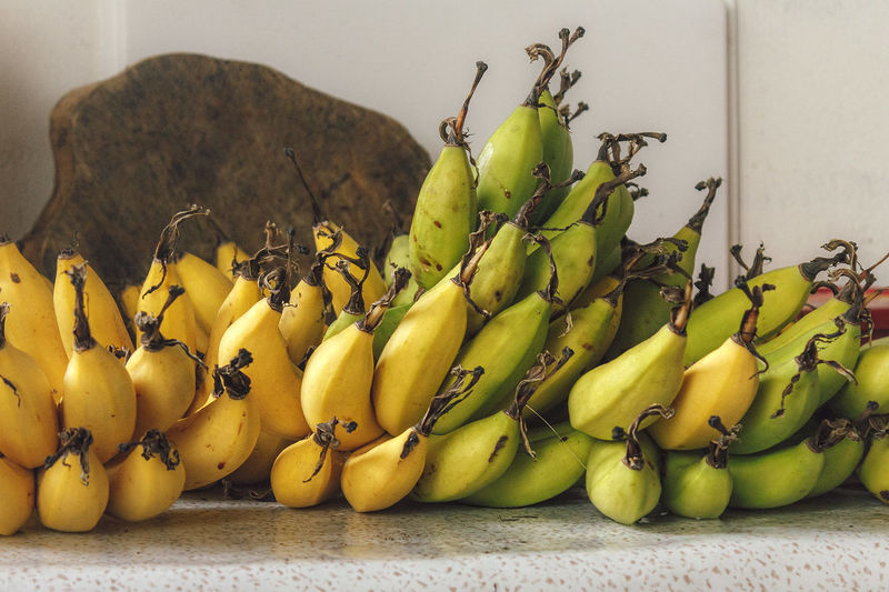 Food Bananas Fruit Yellow Indoors  Freshness Green Color Healthy Eating Vegetable Organic Arrangement In A Row Order Choice Dramatic Angles