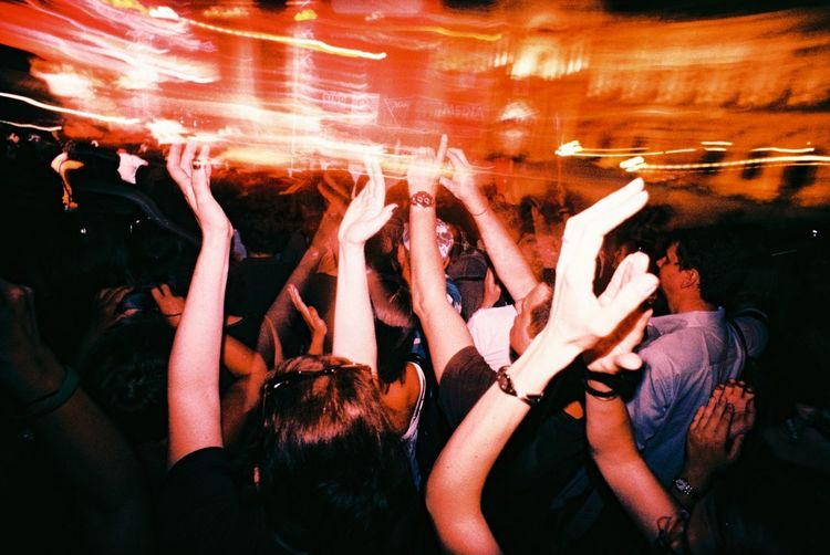 Crowd of people clapping hands on a concert