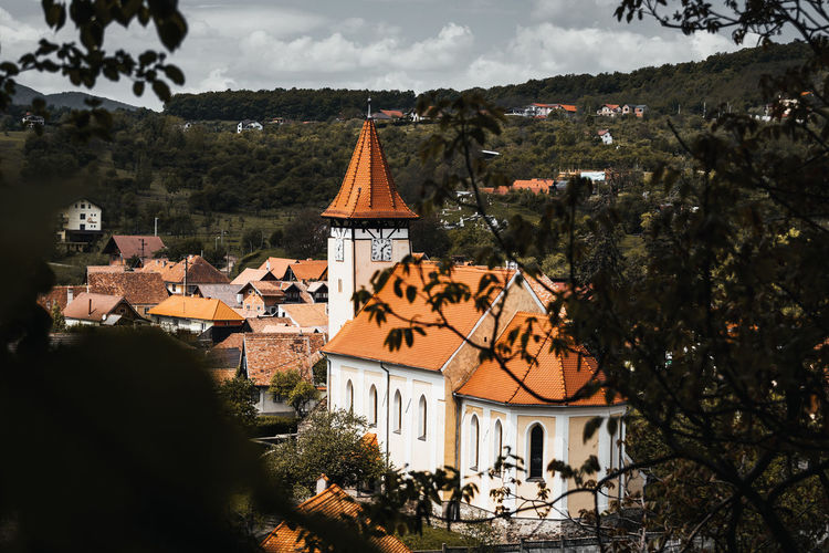 Back To God Built Structure Architecture Building Exterior Building Tree Residential District Plant House Nature Cloud - Sky Sky No People Religion Roof Place Of Worship Day Spirituality Belief Mountain Outdoors TOWNSCAPE Sibiu Romania Destination Explore Discover  Travel Nikon D7500 Old Architecture Medieval Lutheran Church