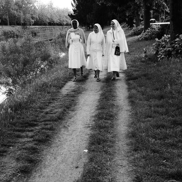 Blackandwhite Black And White Black & White Spiritual Grass Path Pathway Path In Nature Pathways Nuns Walking Walking Around Walking Around The City  Adventures In The City Street Scene