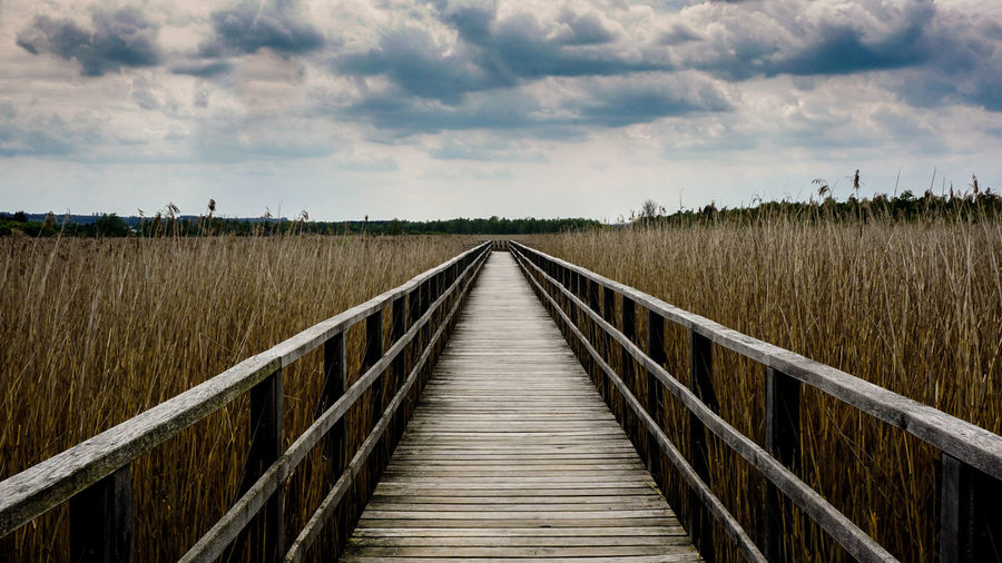 Boardwalk against sky