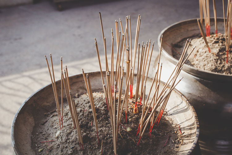 Close-Up Of Incense Sticks In Container