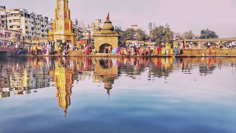 Godavari the ganga of the south River Godavari Ganga EyeEmNewHere Reflection Water Standing Water Lake Floating On Water Travel Destinations No People Outdoors Day Sky Architecture