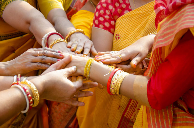 Midsection of women stacking hands