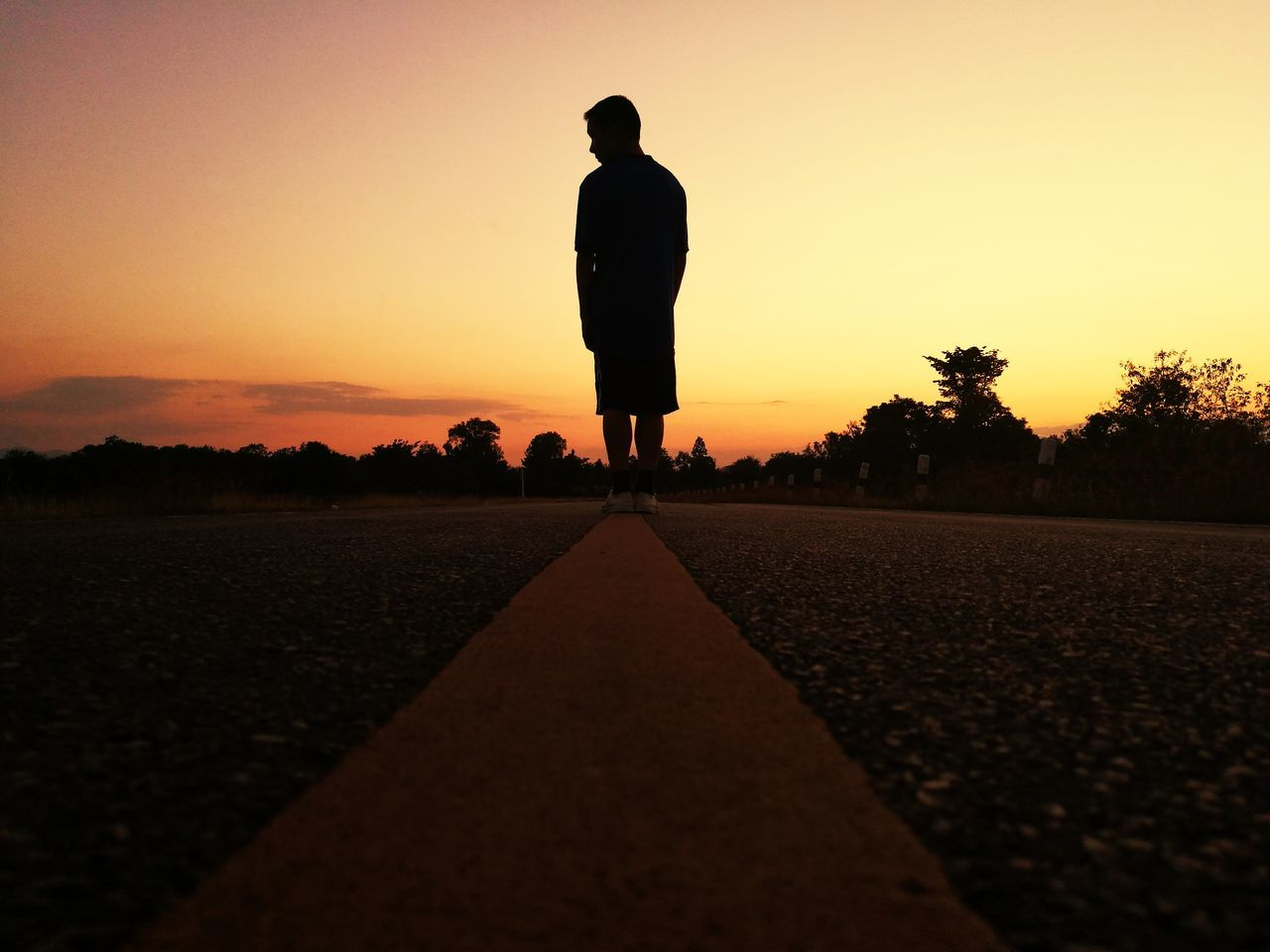 sunset, real people, one person, silhouette, full length, walking, the way forward, standing, road, men, sky, transportation, clear sky, lifestyles, outdoors, nature, day, people