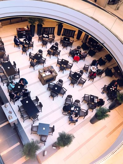 From Above  Tables And Chairs Tables Restaurant High Angle View Transportation Mode Of Transportation City Architecture Group Of People Motor Vehicle Crowd Real People Large Group Of People Built Structure City Life