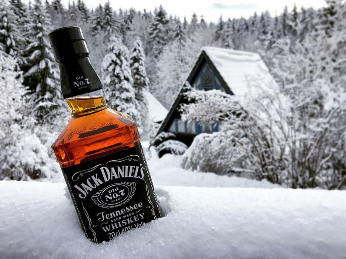 Jack Daniels whiskey in winter mood. Winter Snow Jackdaniels Whiskey No People Tree Outdoors Snowing Nature