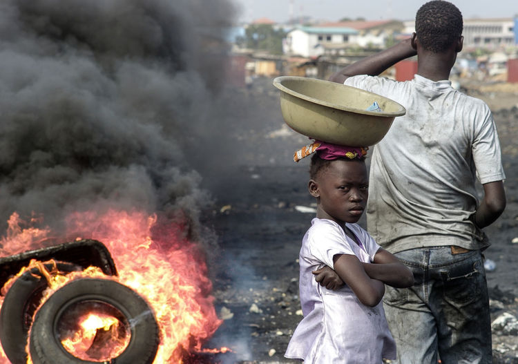 Abogbloshi Accra Burning Child Labour DUMPING SITE Electronical Scrap Ghana Looking At Camera Smoke The Week On EyeEm Africa Day To Day Black Smoke Danger Dumping Rubbish E-waste Hard Labour Photoreportage Reprtage Toxic Tyre Burning Unhealty Waste Focus On The Story