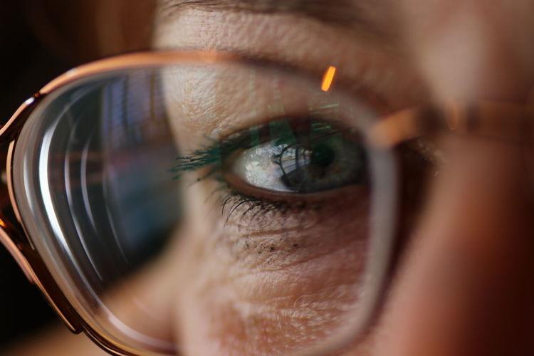 Cropped portrait of woman wearing eyeglasses