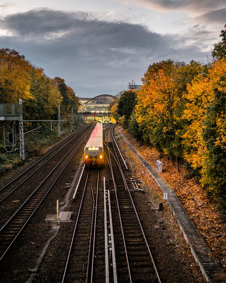 the train is coming Autumn Autumn Colors Bahndamm Berlin S-Bahnhof Schönauser Allee S-bahn Beauty In Nature Cloud - Sky High Angle View Mode Of Transport No People Public Transportation Rail Transportation Railroad Track Scenics Sky Sunset Train Transportation Tree