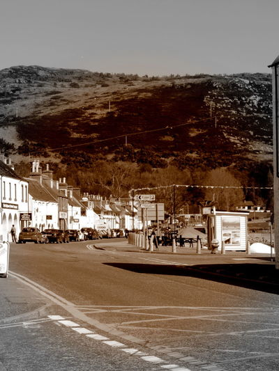 Ullapool Highlands Of Scotland Architecture Building Building Exterior Built Structure Car City Clear Sky Mode Of Transportation Motor Vehicle Mountain Nature No People Outdoors Plant Residential District Road Sky Street Transportation Tree