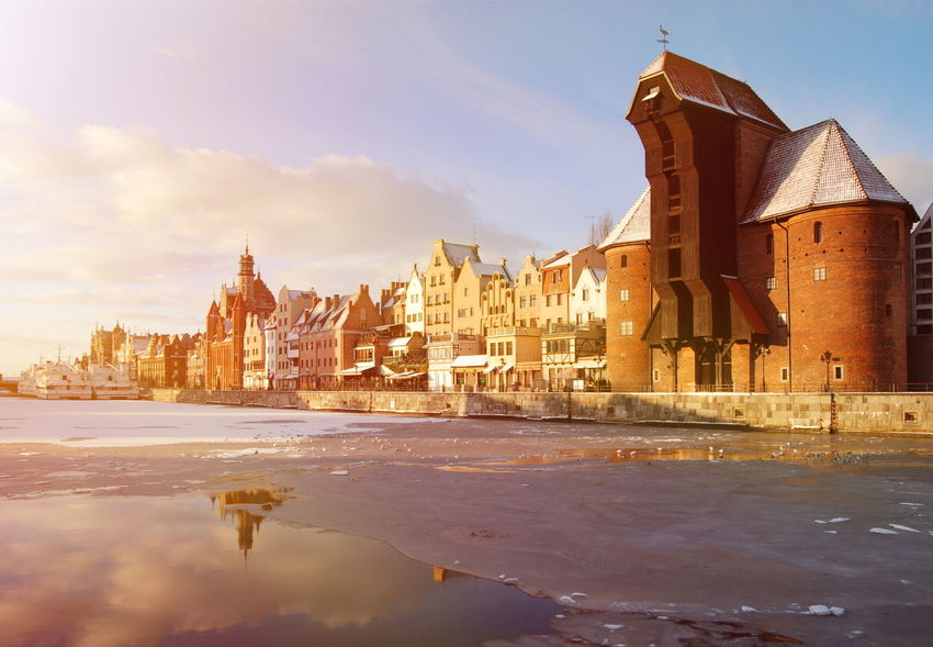 Gdansk old town and famous crane, Polish Zuraw, view from Motlawa river. Architecture Building Exterior Built Structure City Cityscape Crane Day Gdansk Motława No People Old Town Outdoors Sky Skyscraper Snow Sunset Tower Travel Travel Destinations Urban Skyline Winter Żuraw