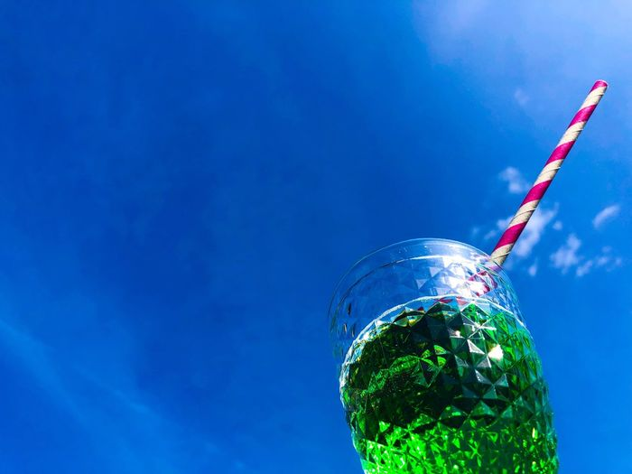 Close-up of drink against blue sky