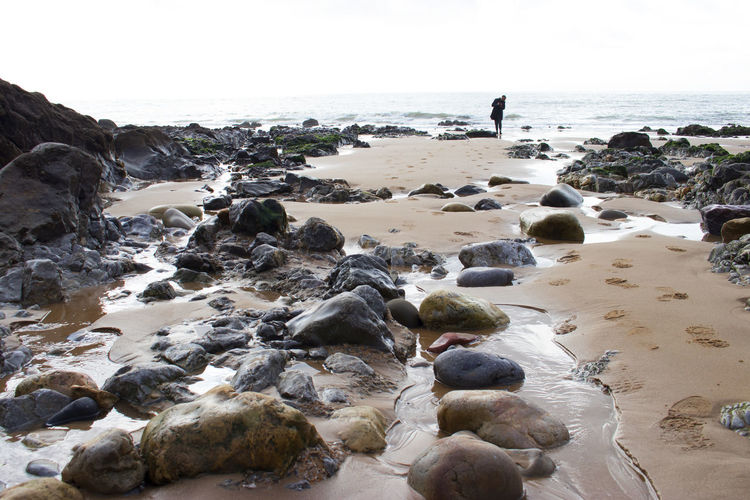 Stranger on the shore One Person Only Beachphotography Foreshore Marine Rocks And Water Sand Sea Sky